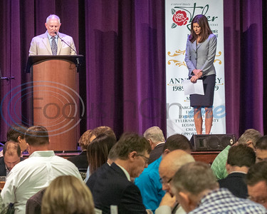 City Councilman Bob Westbrook (L) leads attendees in the invocation at the 30th Annual TEDC Investors and  Contributors Appreciation Luncheon, April 11, 2019 at Crosswalk Convention Center, in Tyler, TX. On the right is Shannon Dacus, TEDC Board Chair. (Rick Flack/Freelance)