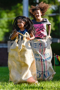 Young girls participate in a potato sack race during an Easter egg hunt at Tyler Junior College in Tyler, Texas, on Thursday, April 13, 2017. Families enjoyed games, jump houses and taking pictures with the Easter Bunny in addition to the Easter egg hunt.(Chelsea Purgahn/Tyler Morning Telegraph)