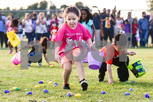 Children search for Easter eggs during an Easter egg hunt at Lindsey Park in Tyler, Texas, on Thursday, April 13, 2017. Families enjoyed games, jump houses and taking pictures with the Easter Bunny in addition to the Easter egg hunt. (Chelsea Purgahn/Tyler Morning Telegraph)