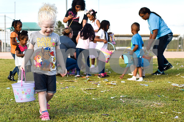 Addison Trice, 3, looks for Easter eggs during an Easter egg hunt at Lindsey Park in Tyler, Texas, on Thursday, April 13, 2017. Families enjoyed games, jump houses and taking pictures with the Easter Bunny in addition to the Easter egg hunt. (Chelsea Purgahn/Tyler Morning Telegraph)