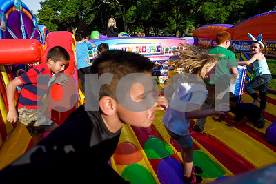 Kids play on a jump house during an Easter egg hunt at Tyler Junior College in Tyler, Texas, on Thursday, April 13, 2017. Families enjoyed games, jump houses and taking pictures with the Easter Bunny in addition to the Easter egg hunt.(Chelsea Purgahn/Tyler Morning Telegraph)