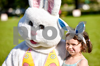 Aria Castaneda, 5 1/2, takes a photo with the Easter Bunny during an Easter egg hunt at Tyler Junior College in Tyler, Texas, on Thursday, April 13, 2017. Families enjoyed games, jump houses and taking pictures with the Easter Bunny in addition to the Easter egg hunt.(Chelsea Purgahn/Tyler Morning Telegraph)