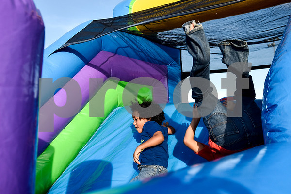 Kids play on an inflatable obstacle course during an Easter egg hunt at Lindsey Park in Tyler, Texas, on Thursday, April 13, 2017. Families enjoyed games, jump houses and taking pictures with the Easter Bunny in addition to the Easter egg hunt. (Chelsea Purgahn/Tyler Morning Telegraph)