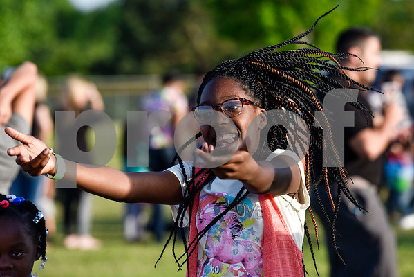 during an Easter egg hunt at Lindsey Park in Tyler, Texas, on Thursday, April 13, 2017. Families enjoyed games, jump houses and taking pictures with the Easter Bunny in addition to the Easter egg hunt. (Chelsea Purgahn/Tyler Morning Telegraph)