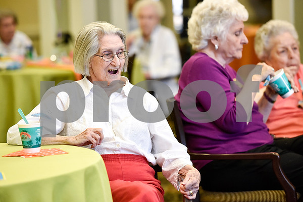 Gretchen Leadh smiles as she sings during a community Easter party at The Hamptons in Tyler, Texas, on Friday, April 14, 2017. The event included live music, snow cones and other snacks, and an Easter egg hunt for children. (Chelsea Purgahn/Tyler Morning Telegraph)