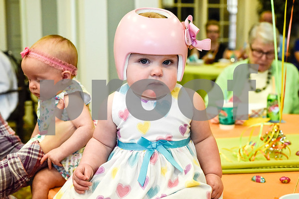 Stella Hall, 9 months, looks at the camera during a community Easter party at The Hamptons in Tyler, Texas, on Friday, April 14, 2017. The event included live music, snow cones and other snacks, and an Easter egg hunt for children. (Chelsea Purgahn/Tyler Morning Telegraph)