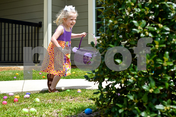 Lyla Richey, 4, smiles as she runs to pick up Easter eggs during a community Easter party at The Hamptons in Tyler, Texas, on Friday, April 14, 2017. The event included live music, snow cones and other snacks, and an Easter egg hunt for children. (Chelsea Purgahn/Tyler Morning Telegraph)