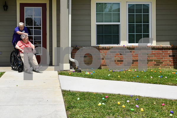 Mary Wilkerson points out Easter eggs to Monnie Cole during a community Easter party at The Hamptons in Tyler, Texas, on Friday, April 14, 2017. The event included live music, snow cones and other snacks, and an Easter egg hunt for children. (Chelsea Purgahn/Tyler Morning Telegraph)