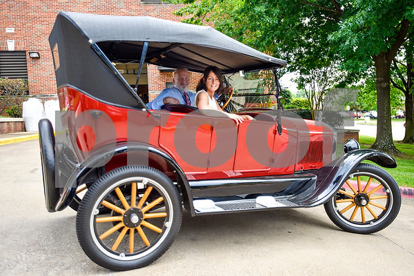 Dr. Mike Metke and Jolanda vandenBerg pose for a portrait in a 1926 Model T at Tyler Junior College in Tyler, Texas, on Tuesday, April 18, 2017. vandenBerg runs a children's programs in Peru for underprivileged and abandoned children and owns and operates a few hotels in the area so she can take care of the children. Dr. Metke was so impressed by her mission during a 1999 visit that he has continued to support her endeavors throughout the past two decades. Dr. Metke invited vandenBerg to speak at the college's International Day. (Chelsea Purgahn/Tyler Morning Telegraph)