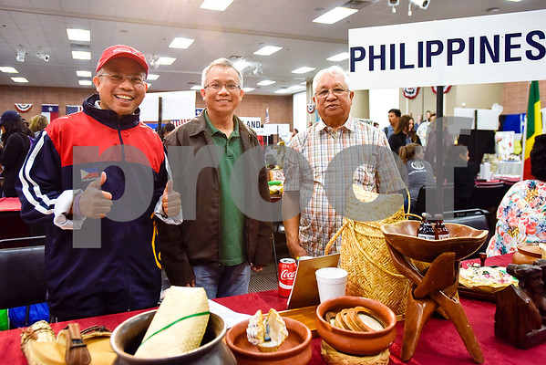 Ed, Kevin and Nestor Santos pose for a photo during Tyler Junior College's International Day in Tyler, Texas, on Tuesday, April 18, 2017. The event featured cultural performances and educational experiences for the community. (Chelsea Purgahn/Tyler Morning Telegraph)