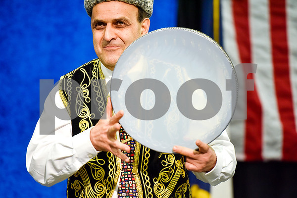 Dr. Manouchehr R. Khosrowshahi performs a song on his gaval during Tyler Junior College's International Day in Tyler, Texas, on Tuesday, April 18, 2017. The event featured cultural performances and educational experiences for the community. (Chelsea Purgahn/Tyler Morning Telegraph)