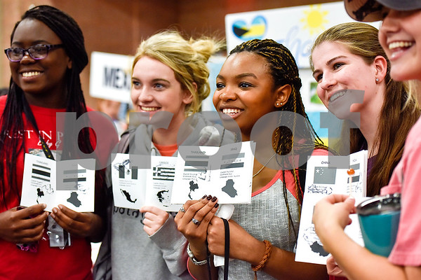 Girls pose for a photo with their event passports during Tyler Junior College's International Day in Tyler, Texas, on Tuesday, April 18, 2017. The event featured cultural performances and educational experiences for the community. (Chelsea Purgahn/Tyler Morning Telegraph)