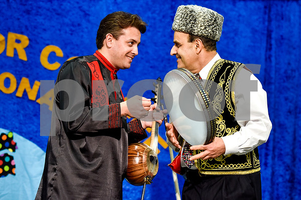 Imamyar Hasanov and Dr. Manouchehr R. Khosrowshahi chat before a performance during Tyler Junior College's International Day in Tyler, Texas, on Tuesday, April 18, 2017. The event featured cultural performances and educational experiences for the community. (Chelsea Purgahn/Tyler Morning Telegraph)