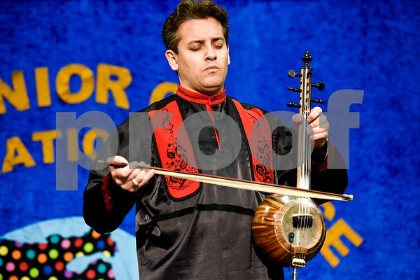 Imamyar Hasanov performs a song on his skin face spike fiddle during Tyler Junior College's International Day in Tyler, Texas, on Tuesday, April 18, 2017. The event featured cultural performances and educational experiences for the community. (Chelsea Purgahn/Tyler Morning Telegraph)