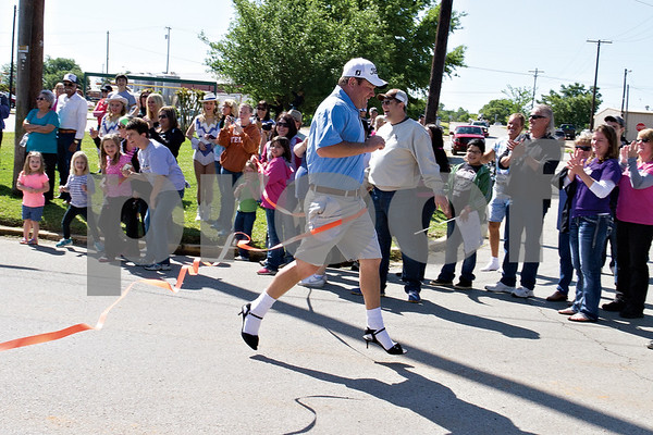 Photo by Shannon Wilson / Tyler Morning Telegraph J.R. Ault of Jacksonville wins a 100 yard dash in his high heel shoes at the completion of the 2013 Walk-A-Mile-In-Her-Shoes in Jacksonville on Saturday.