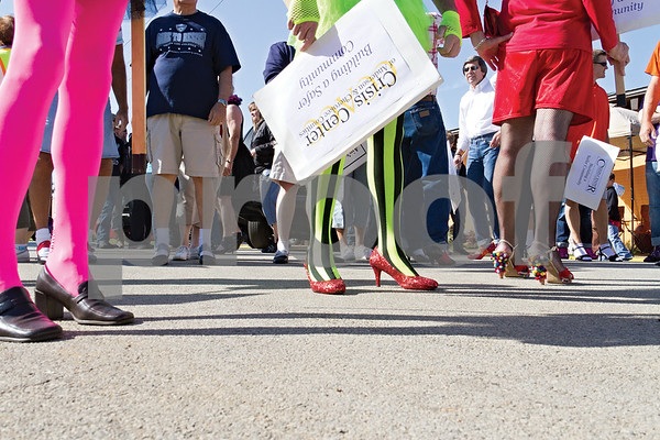Photo by Shannon Wilson / Tyler Morning Telegraph Men gather at Sadler's Restaurant in Jacksonville to participate in Walk-A-Mile-In-Her-Shoes 2013, a walk to raise awareness and funds for the Crisis Center of Cherokee County.