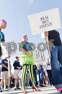 Photo by Shannon Wilson / Tyler Morning Telegraph Danny Smith from Palestine is walking a mile in high heel shoes to raise money and awareness for The Crisis Center of Cherokee County.