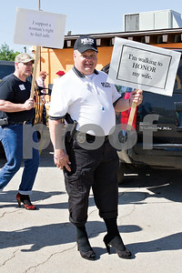 Photo by Shannon Wilson / Tyler Morning Telegraph Doug Yount of the Jacksonville Police Department completed the one mile walk in high heel shoes to raise money and awareness for The Crisis Center of Cherokee County.