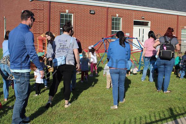 Parents helped their children hunt eggs at the Easter Eggstavaganza at First Baptist Church in Bullard. Sarah Perez/Freelance