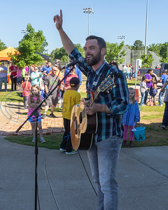 Casey Rivers sings for the attendees during the 4th Annual Community of Whitehouse Easter Egg Hunt, Saturday,  April  20th,  at the Whitehouse Sports Complex in Tyler, Tx. (Rick Flack/Freelance)