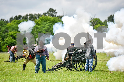 Cannons fire at the end of the national anthem during the fifth annual 1836 Chuckwagon Race presented by Diamond Ranch in Neches, Texas, on Friday, April 21, 2017. Hundreds came to the event to see cattle roping, horse racing, live music and more. (Chelsea Purgahn/Tyler Morning Telegraph)