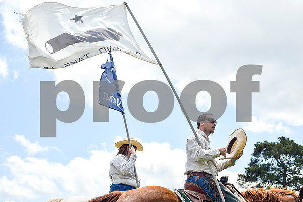 Jonathan Smith takes his hat off for a moment during the fifth annual 1836 Chuckwagon Race presented by Diamond Ranch in Neches, Texas, on Friday, April 21, 2017. Hundreds came to the event to see cattle roping, horse racing, live music and more. (Chelsea Purgahn/Tyler Morning Telegraph)