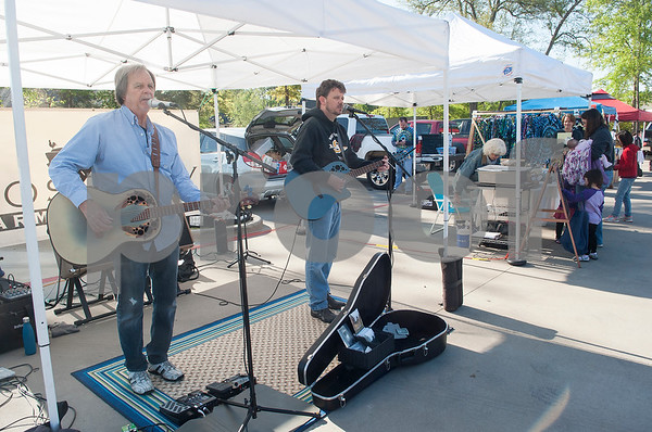 The Eric Moseley Duo performs at the Rose City Farmers Market held in the parking lot of Juls Saturday April 2, 2016.  (Sarah A. Miller/Tyler Morning Telegraph)