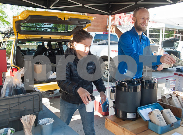 Shelly and Jonathan Ramm of Porch Culture Coffee Roasters sell cups of coffee at the Rose City Farmers Market held in the parking lot of Juls Saturday April 2, 2016.  (Sarah A. Miller/Tyler Morning Telegraph)