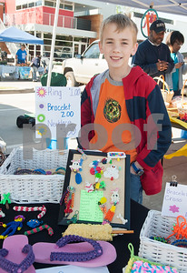 Caden Hendrix, 11, sells creations made from rubber bands at the Rose City Farmers Market held in the parking lot of Juls Saturday April 2, 2016.  (Sarah A. Miller/Tyler Morning Telegraph)