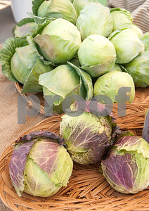 Cabbages from Red Moon Farm are for sale at the Rose City Farmers Market held in the parking lot of Juls Saturday April 2, 2016.  (Sarah A. Miller/Tyler Morning Telegraph)