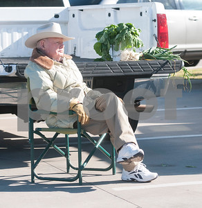 Farmer Foy Magee sells produce at the Rose City Farmers Market held in the parking lot of Juls Saturday April 2, 2016.  (Sarah A. Miller/Tyler Morning Telegraph)