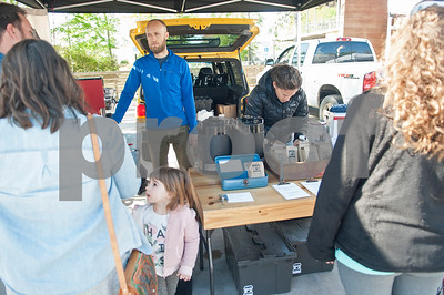 Jonathan and Shelly Ramm of Porch Culture Coffee Roasters sell cups of coffee at the Rose City Farmers Market held in the parking lot of Juls Saturday April 2, 2016.  (Sarah A. Miller/Tyler Morning Telegraph)