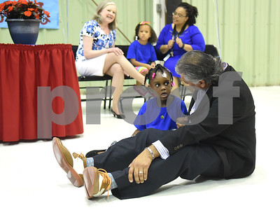 Rawly Sanchez, Tyler ISD Chief Administrative Officer Area 2 sings a song with student Camari Freeman-Bland during the Smith County Child Abuse Awareness Proclamation Day Program at St. Louis Early Childhood Center Friday April 22, 2016.  (Sarah A. Miller/Tyler Morning Telegraph)