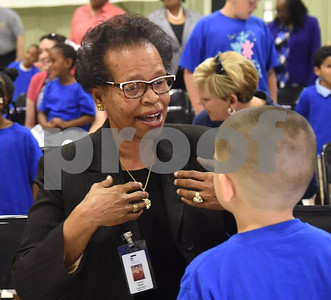 Rev. Orenthia Mason sings to a student during the Smith County Child Abuse Awareness Proclamation Day Program at St. Louis Early Childhood Center Friday April 22, 2016.  (Sarah A. Miller/Tyler Morning Telegraph)