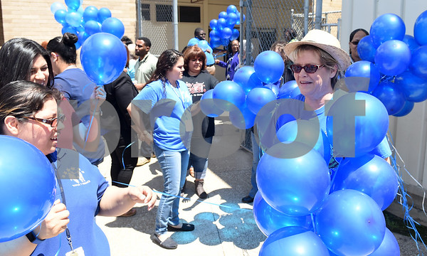 Blue balloons are passed out to school staff, students and visitors during the Smith County Child Abuse Awareness Proclamation Day Program at St. Louis Early Childhood Center Friday April 22, 2016.  (Sarah A. Miller/Tyler Morning Telegraph)