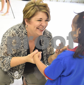 Dr. Christy Hanson sings to a student during the Smith County Child Abuse Awareness Proclamation Day Program at St. Louis Early Childhood Center Friday April 22, 2016.  (Sarah A. Miller/Tyler Morning Telegraph)