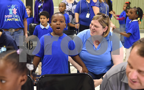 Head Start student T'Koby Adams, 5, and Heather Jones of the Children's Advocacy Center sing together during the Smith County Child Abuse Awareness Proclamation Day Program at St. Louis Early Childhood Center Friday April 22, 2016.  (Sarah A. Miller/Tyler Morning Telegraph)