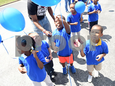 Head Start students release blue balloons during the Smith County Child Abuse Awareness Proclamation Day Program at St. Louis Early Childhood Center Friday April 22, 2016.  (Sarah A. Miller/Tyler Morning Telegraph)