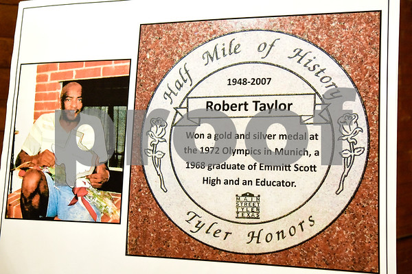 A photo of Robert Taylor and his Half Mile of History marker during a ceremony held to unveil a new Half Mile of History marker honoring Robert Taylor at Gallery Main Street in Tyler, Texas, on Tuesday, April 24, 2018. Taylor was an American track and field sprinter, winner of the gold medal in 4×100-meter relay and silver medalist in the 100 meters at the 1972 Summer Olympics. (Chelsea Purgahn/Tyler Morning Telegraph)