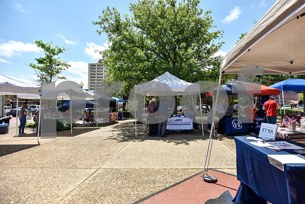 Nonprofit organizations sit at booths under tents during East Texas Giving Day at T.B. Butler Fountain Plaza in Tyler, Texas, on Tuesday, April 25, 2017. East Texas Giving Day is designed to make the most of social media by getting donors to share the fact that they made a donation with their friends and followers on social media. The hope is for those shares to inspire interest and potentially more donations. (Chelsea Purgahn/Tyler Morning Telegraph)