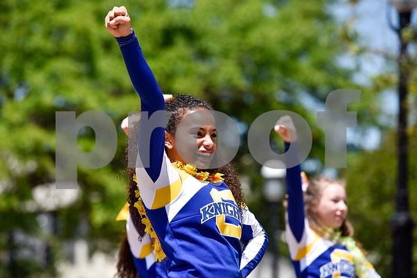 Cumberland Academy cheerleaders perform during East Texas Giving Day at T.B. Butler Fountain Plaza in Tyler, Texas, on Tuesday, April 25, 2017. East Texas Giving Day is designed to make the most of social media by getting donors to share the fact that they made a donation with their friends and followers on social media. The hope is for those shares to inspire interest and potentially more donations. (Chelsea Purgahn/Tyler Morning Telegraph)