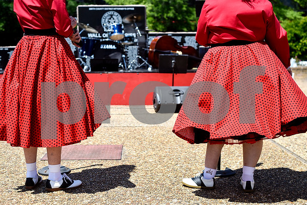 Ladies wearing poodle skirts set up microphones during East Texas Giving Day at T.B. Butler Fountain Plaza in Tyler, Texas, on Tuesday, April 25, 2017. East Texas Giving Day is designed to make the most of social media by getting donors to share the fact that they made a donation with their friends and followers on social media. The hope is for those shares to inspire interest and potentially more donations. (Chelsea Purgahn/Tyler Morning Telegraph)