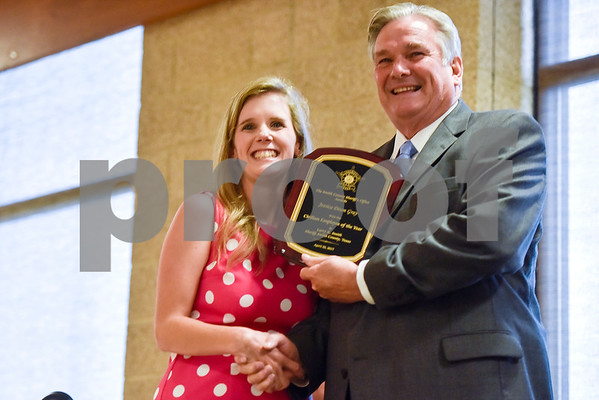 Smith County Sheriff Larry R. Smith shakes hands with an award recipient while posing for a photo during the Smith County Sheriff's Office Awards Banquet at the Rose Garden Center in Tyler, Texas, on Tuesday, April 25, 2017. The banquet honored outstanding members of the staff for their contributions in 2016. (Chelsea Purgahn/Tyler Morning Telegraph)