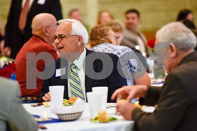 James Gregory laughs while talking with others during the Smith County Sheriff's Office Awards Banquet at the Rose Garden Center in Tyler, Texas, on Tuesday, April 25, 2017. The banquet honored outstanding members of the staff for their contributions in 2016. (Chelsea Purgahn/Tyler Morning Telegraph)