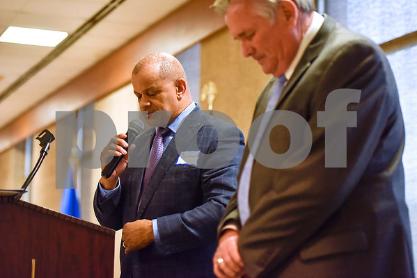 Reverend Ralph Caraway Sr. leads attendees in prayer during the Smith County Sheriff's Office Awards Banquet at the Rose Garden Center in Tyler, Texas, on Tuesday, April 25, 2017. The banquet honored outstanding members of the staff for their contributions in 2016. (Chelsea Purgahn/Tyler Morning Telegraph)