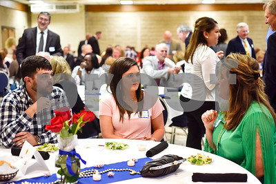 People chat during the Smith County Sheriff's Office Awards Banquet at the Rose Garden Center in Tyler, Texas, on Tuesday, April 25, 2017. The banquet honored outstanding members of the staff for their contributions in 2016. (Chelsea Purgahn/Tyler Morning Telegraph)