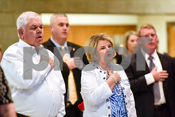 People say the pledge of allegiance during the Smith County Sheriff's Office Awards Banquet at the Rose Garden Center in Tyler, Texas, on Tuesday, April 25, 2017. The banquet honored outstanding members of the staff for their contributions in 2016. (Chelsea Purgahn/Tyler Morning Telegraph)