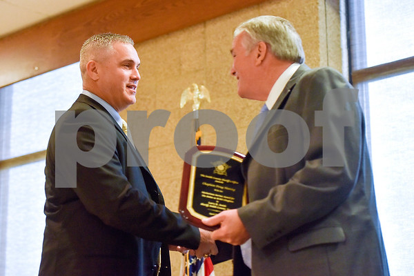 Smith County Sheriff Larry R. Smith, right, shakes hands with an award recipient during the Smith County Sheriff's Office Awards Banquet at the Rose Garden Center in Tyler, Texas, on Tuesday, April 25, 2017. The banquet honored outstanding members of the staff for their contributions in 2016. (Chelsea Purgahn/Tyler Morning Telegraph)