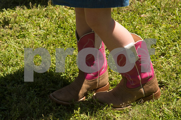 A girl wears boots during Kids' Kaleidoscope Preschool's annual Texas Day event at Pollard United Methodist Church in Tyler, Texas, on Thursday, April 26, 2018. (Chelsea Purgahn/Tyler Morning Telegraph)