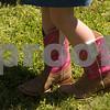 A girl wears boots during Kids' Kaleidoscope Preschool's annual Texas Day event at Pollard United Methodist Church in Tyler, Texas, on Thursday, April 26, 2018. (Chelsea Purgahn/Tyler Morning Telegraph)